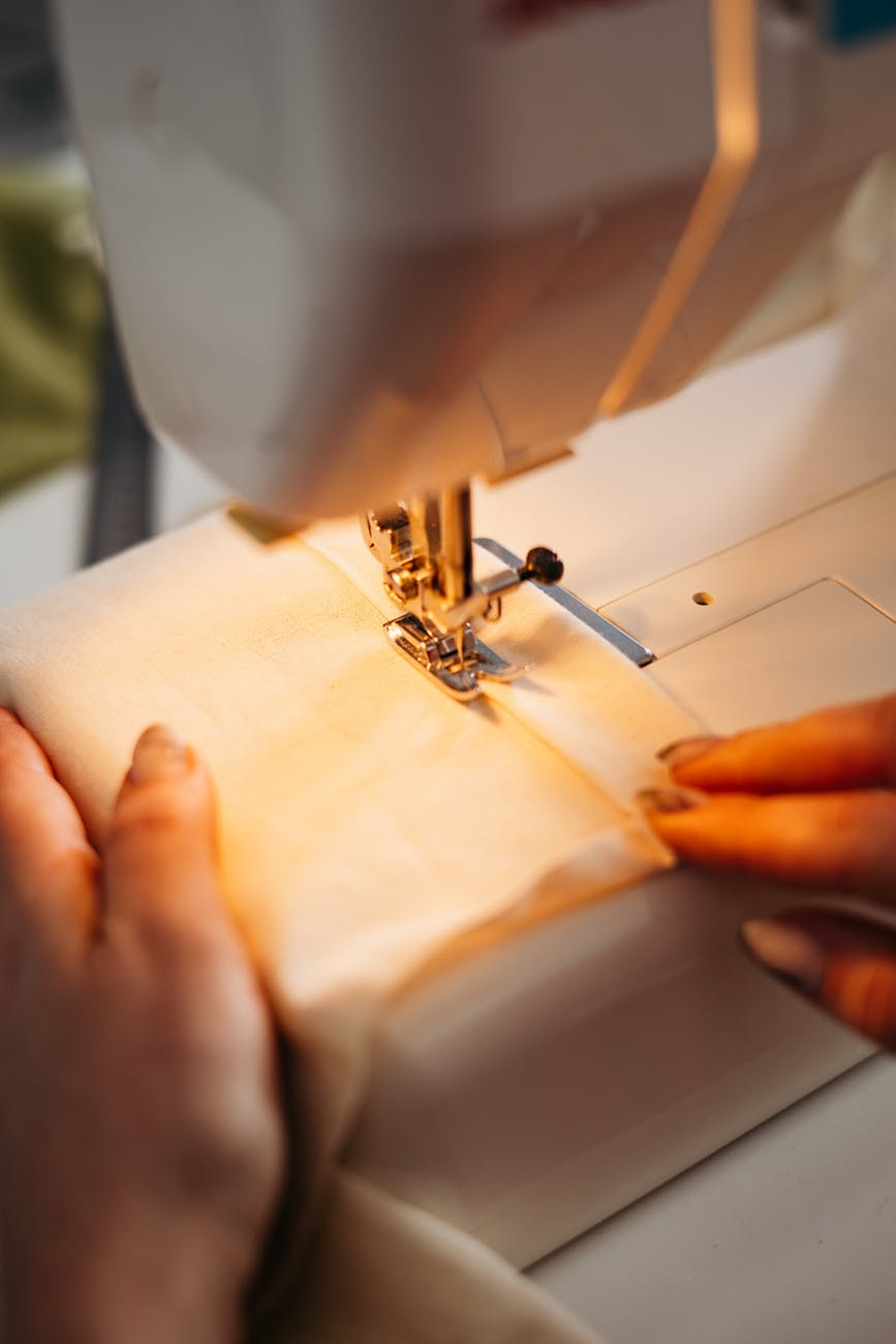 person sewing a fabric